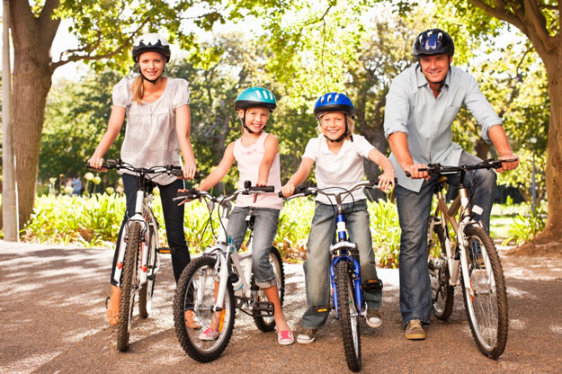 Happy family on rental bikes