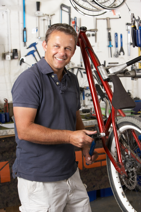 Bike mechanic in repair area